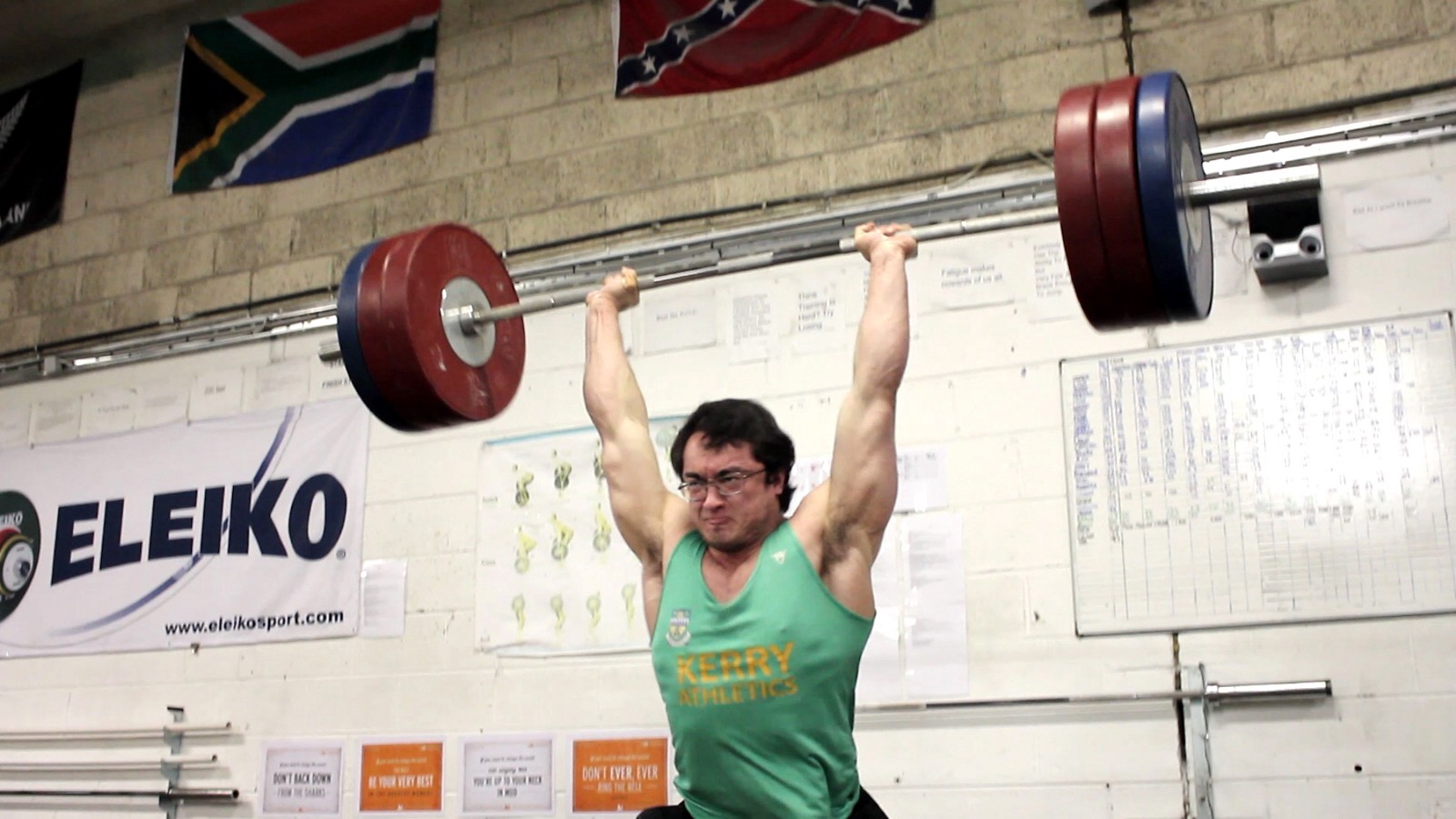 Clarence with barbell overhead