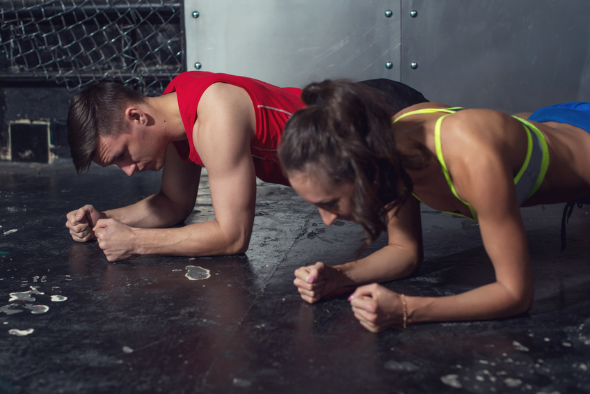 Man and Woman Performing Planks